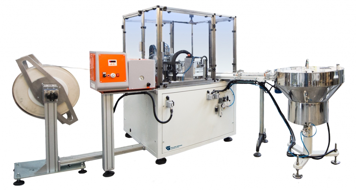 Assemblatrice rotativa a intermittenza taglio e inserimento liner