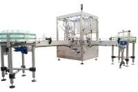 Rotary intermittent filler machine with capper